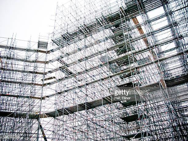 Building with scaffolding at construction site