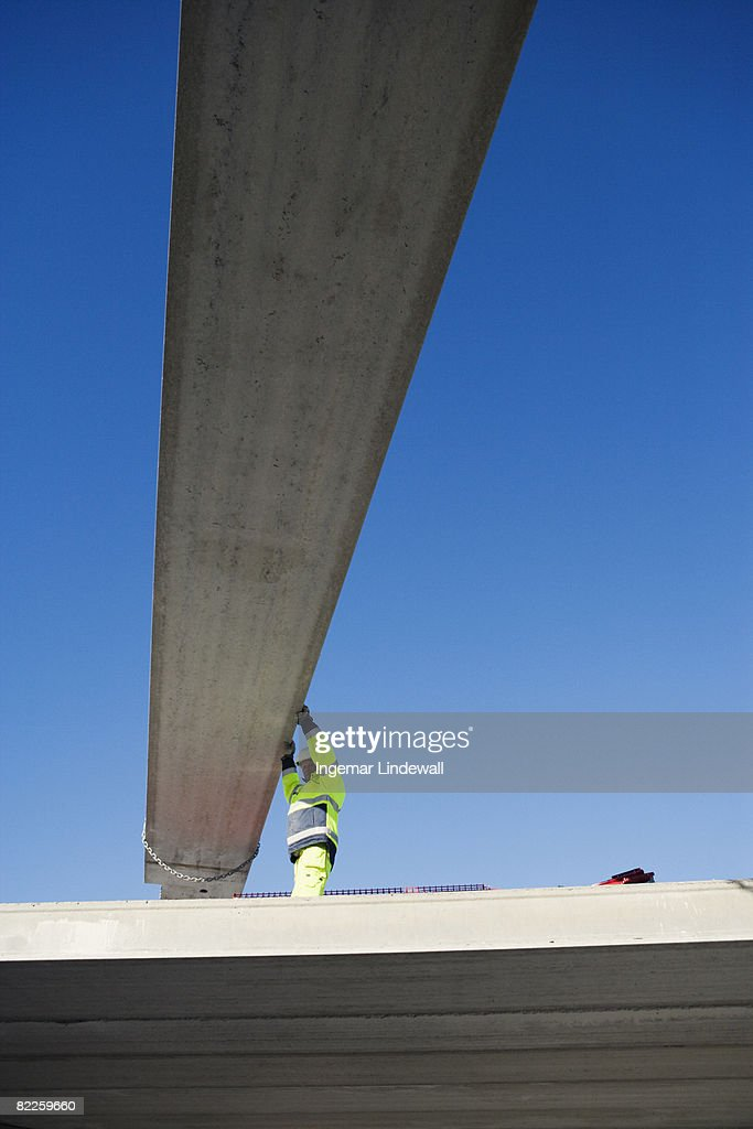 A building worker at a building site Sweden. : Stock Photo