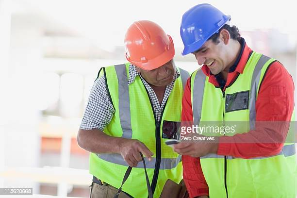 Building workers writing an sms