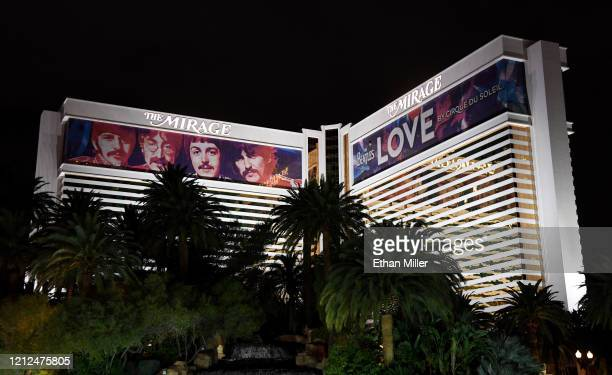 """Building wraps for the """"The Beatles LOVE by Cirque du Soleil"""" show are shown on the exterior of The Mirage Hotel Casino as the coronavirus continues..."""