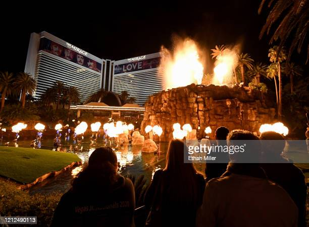 """Building wraps for the """"The Beatles LOVE by Cirque du Soleil"""" show are shown on the exterior of The Mirage Hotel Casino as visitors watch the..."""