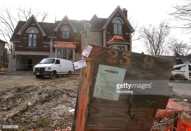 Building-permit sign is visible is posted in front of a new single-family home under construction in Park Ridge, Illinois Friday, November 17, 2006....