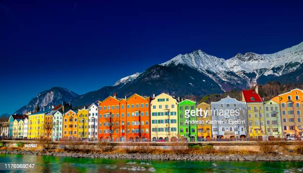 buildings against blue sky during winter - innsbruck stock pictures, royalty-free photos & images