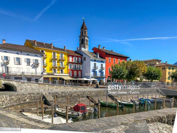 buildings against blue sky - ascona stock pictures, royalty-free photos & images