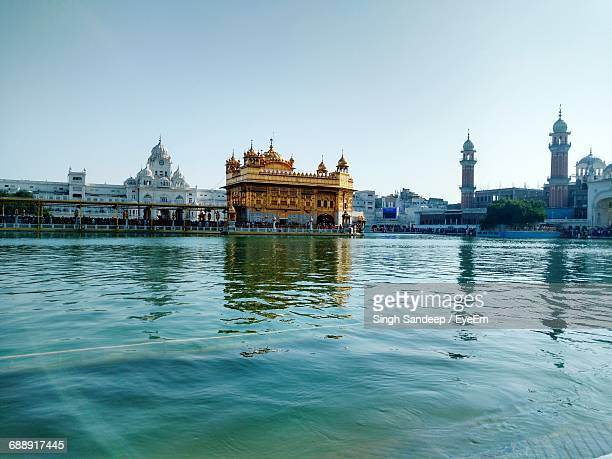 buildings against clear sky - golden temple india stock pictures, royalty-free photos & images