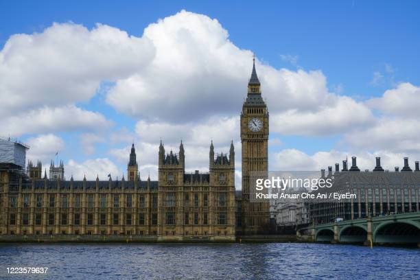 buildings against cloudy sky in city - victoria tower stock pictures, royalty-free photos & images