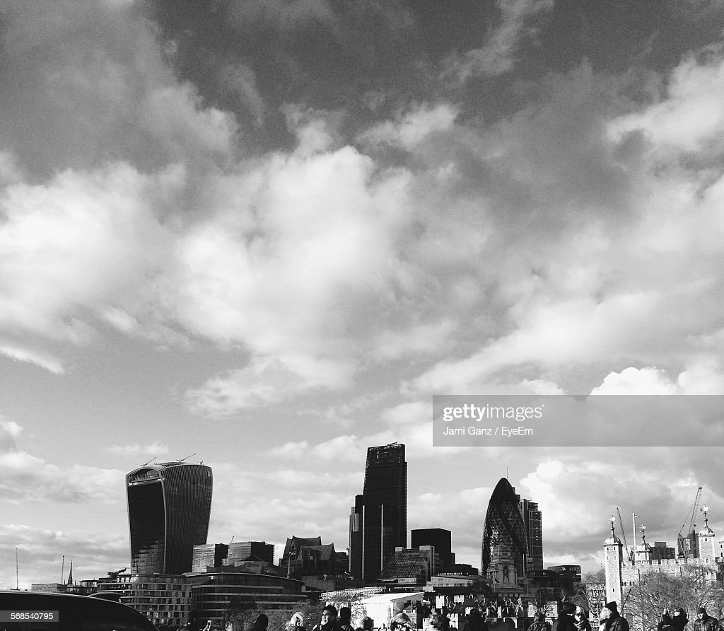 Buildings Against Cloudy Sky In City : Stock Photo