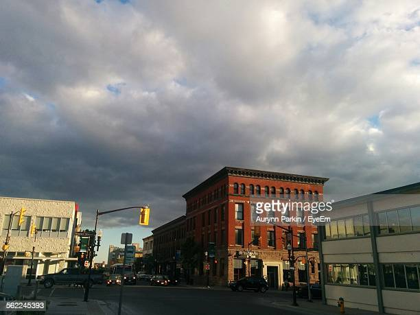 buildings against cloudy sky - peterborough ontario stock photos and pictures