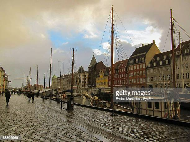 buildings against cloudy sky - nyhavn stock pictures, royalty-free photos & images