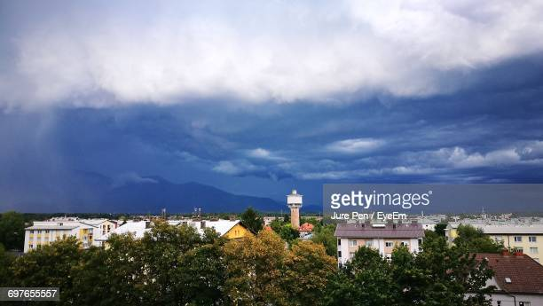 buildings against cloudy sky - kranj stock pictures, royalty-free photos & images
