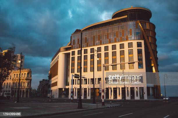buildings against sky at dusk - bortes stock pictures, royalty-free photos & images