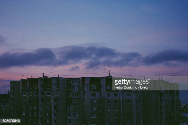 buildings against sky at dusk - fedor stock pictures, royalty-free photos & images