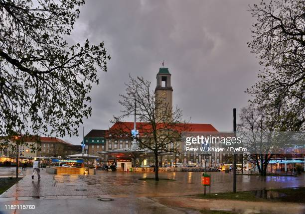 buildings against sky during rainy season - spandau stock pictures, royalty-free photos & images