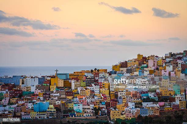 buildings against sky during sunset in city - las palmas de gran canaria stock pictures, royalty-free photos & images