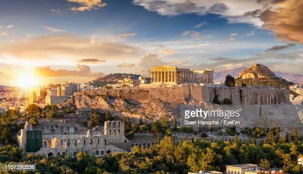 buildings against sky during sunset - parthenon athens stock pictures, royalty-free photos & images