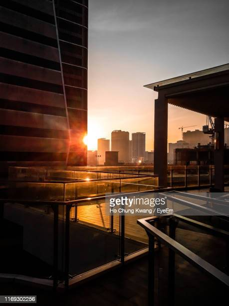 buildings against sky during sunset - railings stock pictures, royalty-free photos & images