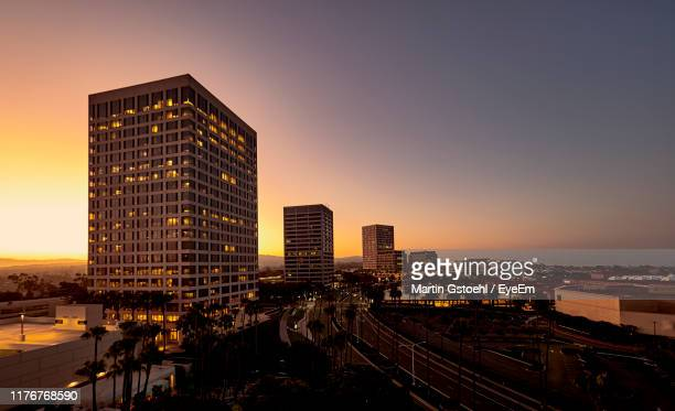 buildings against sky during sunset - newport beach california stock pictures, royalty-free photos & images