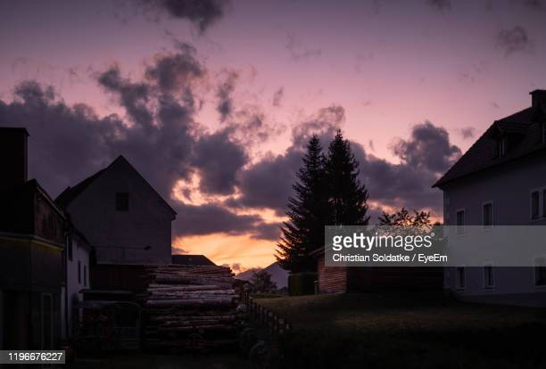 buildings against sky during sunset - christian soldatke stock pictures, royalty-free photos & images