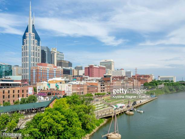 buildings against sky in city - nashville stock pictures, royalty-free photos & images