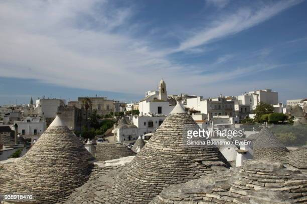 buildings against sky in city - alberobello stock pictures, royalty-free photos & images