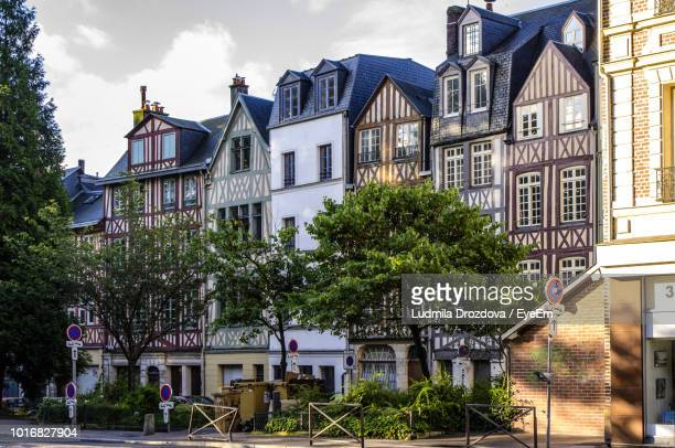 buildings against sky in town - rouen stock pictures, royalty-free photos & images