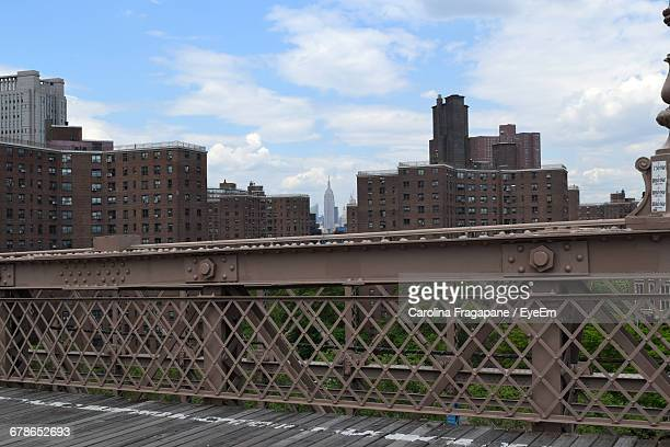 buildings against sky seen from brooklyn bridge - carolina fragapane stock pictures, royalty-free photos & images