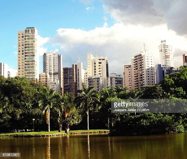 buildings against the sky with waterfront - goiania stock pictures, royalty-free photos & images