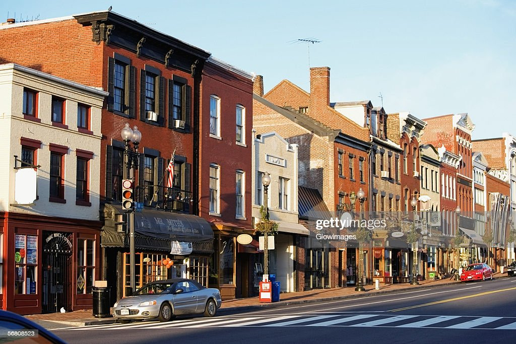 Buildings along a road, M street, Georgetown, Washington DC, USA : Stock Photo