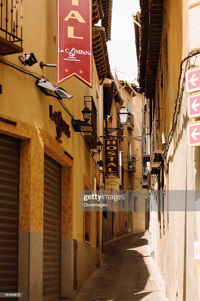 Buildings along an alley, Toledo, Spain : Stock Photo