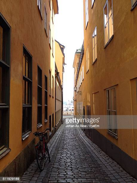 buildings along narrow alley - narrow stock pictures, royalty-free photos & images