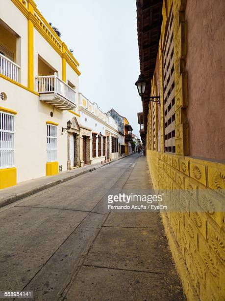 buildings along narrow street - barranquilla stock photos and pictures
