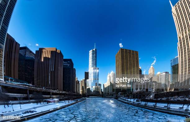 buildings along the frozen chicago river - ken ilio stock pictures, royalty-free photos & images