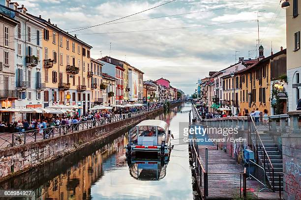 Buildings Amidst Canal At Naviglio Grande Against Sky
