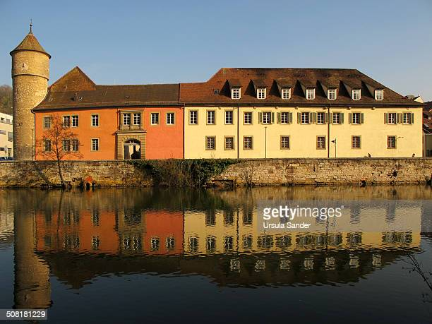 CONTENT] Buildings and a historic tower with reflections in the river Kocher which is in the foreground in Schwäbisch Hall Germany