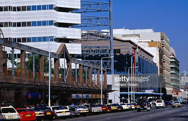 Buildings and cars along Jason Moya Avenue, Harare.