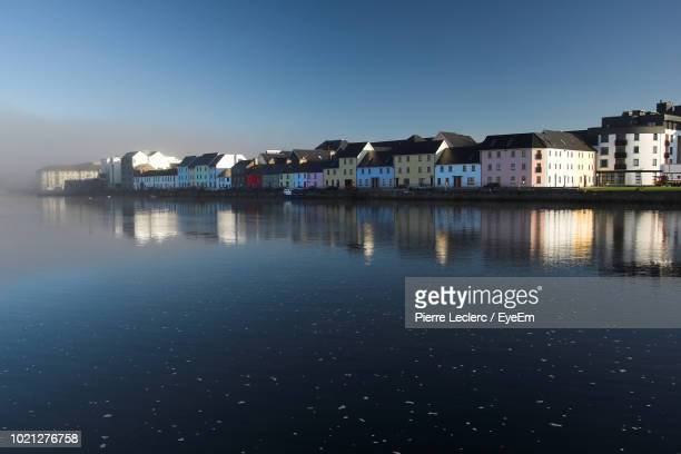 buildings and houses against clear blue sky - galway fotografías e imágenes de stock