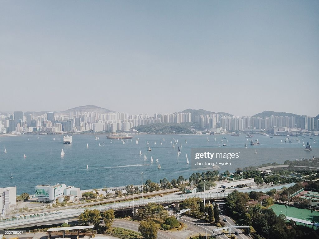 Buildings And Lake Against Clear Sky : Foto stock