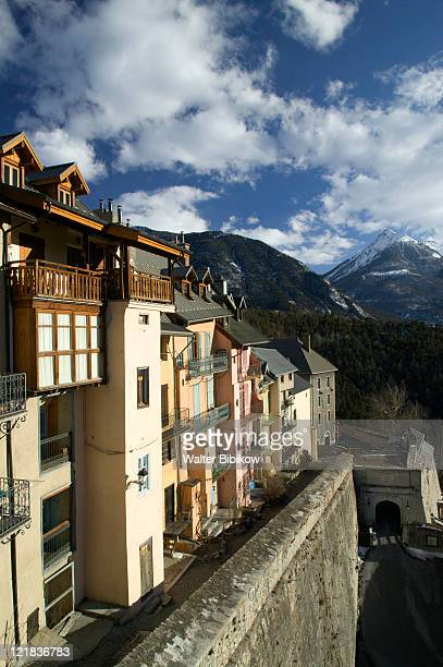buildings and porte d'embrun gate, ville haute - embrun stock photos and pictures