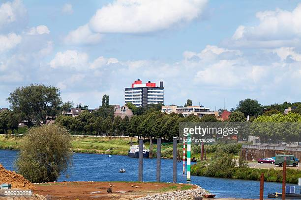 buildings and river mass in venlo - meuse river stock photos and pictures