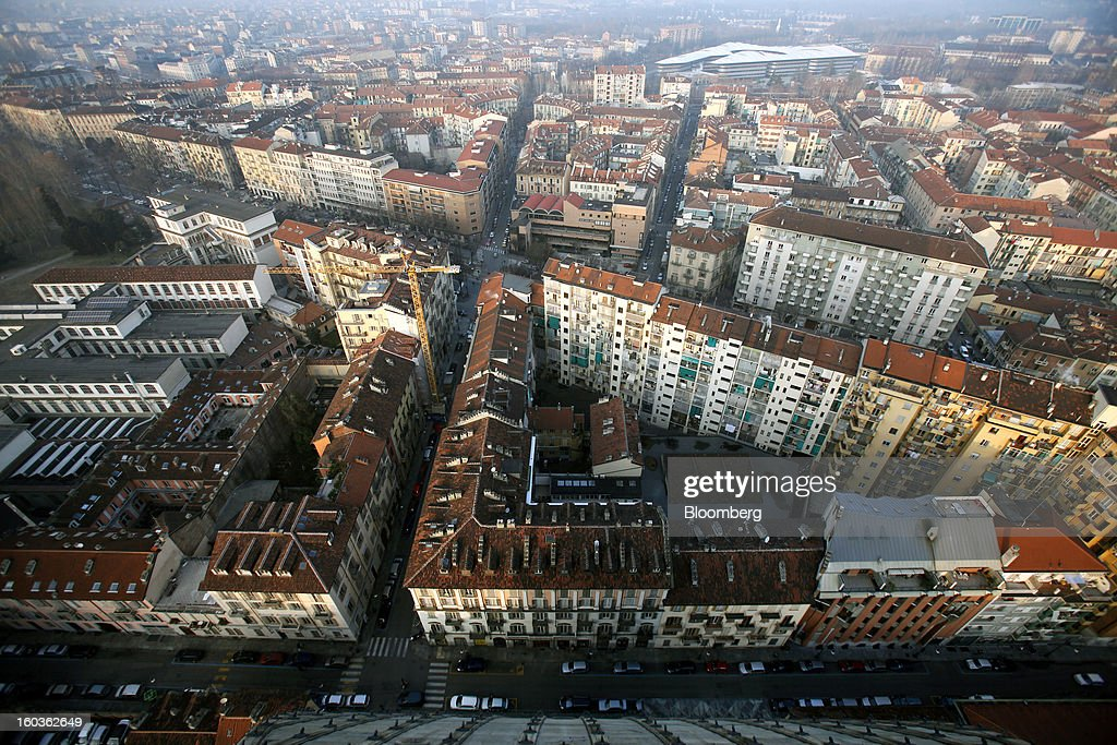 Buildings and streets are seen in this aerial view from the top of the Mole Antonelliana in Turin, Italy, on Tuesday, Jan. 29, 2013. Italy sold 8.5 billion euros ($11.4 billion) of six-month Treasury bills as rates dropped to the lowest in almost three years as the European Central Bank's pledge to buy bonds continues to provide an effective backstop even amid rising political concerns. Photographer: Alessia Pierdomenico/Bloomberg via Getty Images