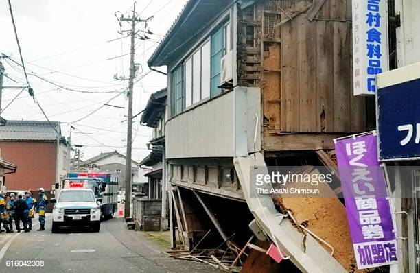 Buildings are damaged after the magnitude 66 earthquake hit the area on October 21 2016 in Hokuei Tottori Japan A quake measuring lower 6 on the...