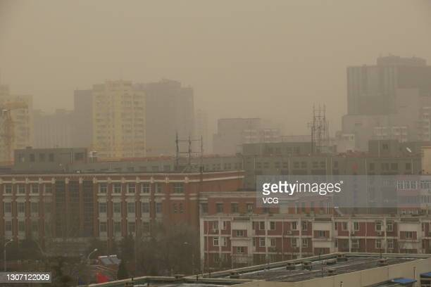 Buildings are pictured in sandstorm on March 15, 2021 in Beijing, China. Sandstorm blankets parts of regions in north China on Monday, said the...
