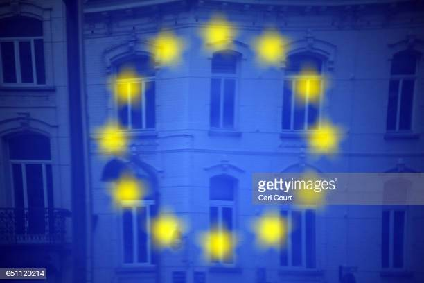 Buildings are reflected in an EU sign outside the European Commission headquarters on March 10 2017 in Brussels Belgium EU leaders have gathered for...