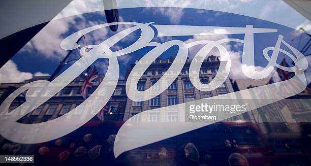 Buildings are reflected in the window of a Boots store operated by Alliance Boots in London UK on Tuesday June 19 2012 Walgreen Co the largest US...