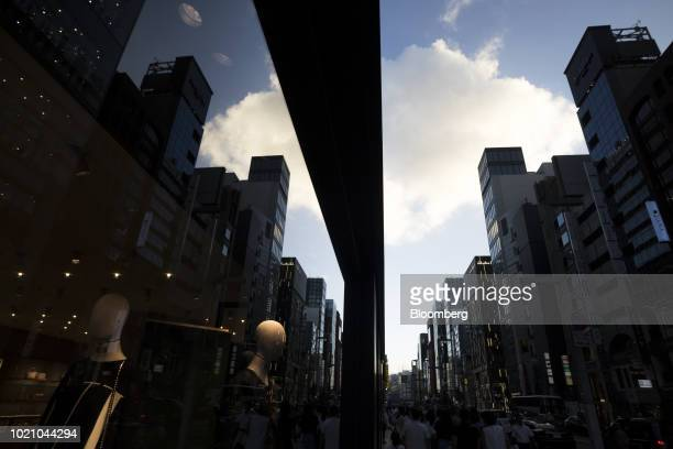 Buildings are reflected in the window of a store in the Ginza area of Tokyo Japan on Tuesday Aug 21 2018 Japan is scheduled to release February's...