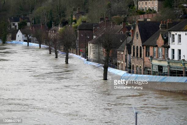 Buildings are seen behind temporary flood barriers that are overwhelmed by water from the River Severn on February 26, 2020 in Ironbridge, England....