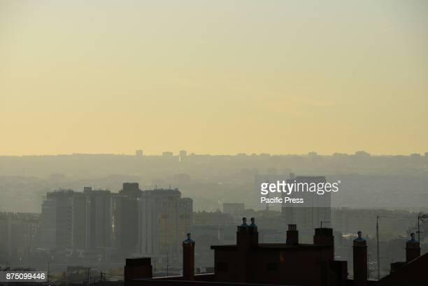 Buildings are seen covered with toxic smog in Madrid where air pollution is reaching dangerous levels for human health by the high concentration of...