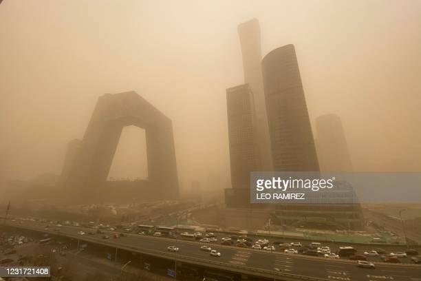 Buildings are seen in the central business district of Beijing during a sandstorm on March 15, 2021.