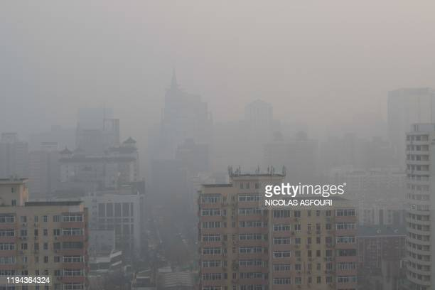 Buildings are seen on a polluted day in Beijing on January 18 2020