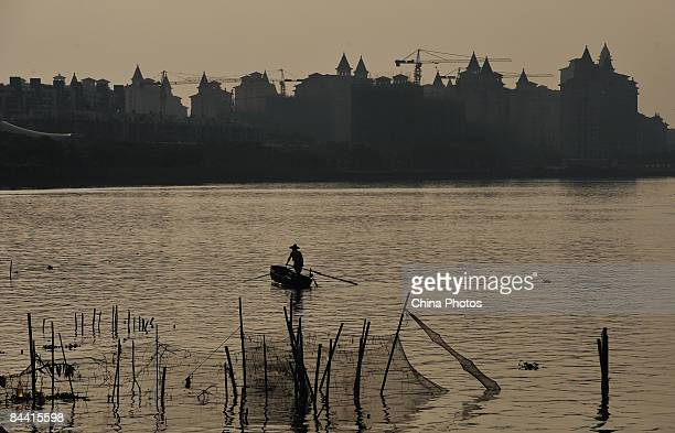 Buildings are seen on the shore of Pearl River in Panyu District where used to be the city suburb on October 21 2008 in Guangzhou of Guangdong...